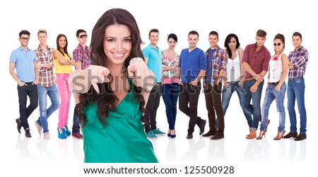 young casual woman choosing you for her team by pointing her finger - stock photo