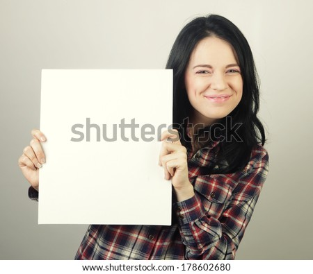 young casual woman happy holding blank sign  - stock photo