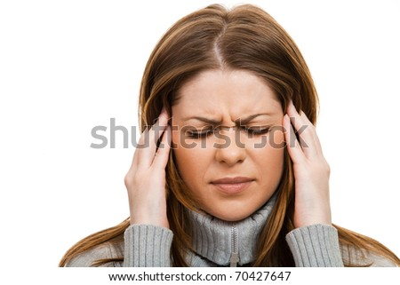 Young casual woman having a headache, close up { isolated on white }