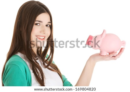 Young casual woman holding piggy-bank. Isolated on white. - stock photo