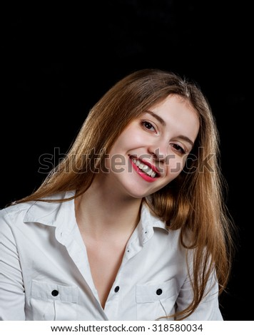 Young casual woman isolated over black background studio portrait