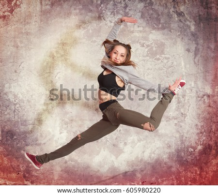 Young casual woman jumping on grey background