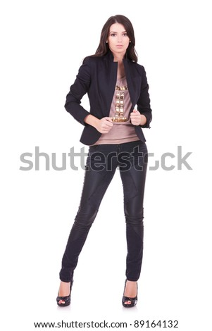young casual woman pulling her jacket, on white background