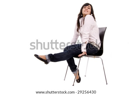 Young casual woman sitting on chair