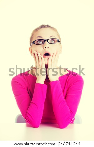 Young casual woman student expresses surprise.  - stock photo
