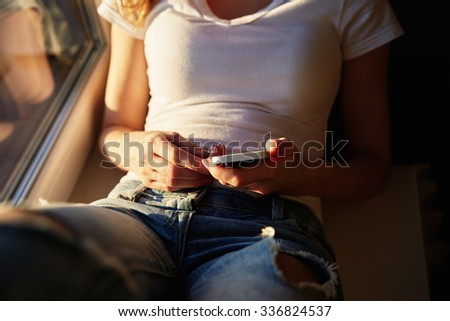 young casual woman using smart phone  at home