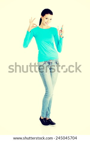 Young casual woman with glass of fresh water. - stock photo