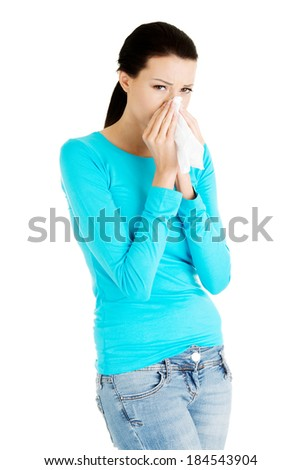 Young casual woman with tissue.  Isolated on white. - stock photo
