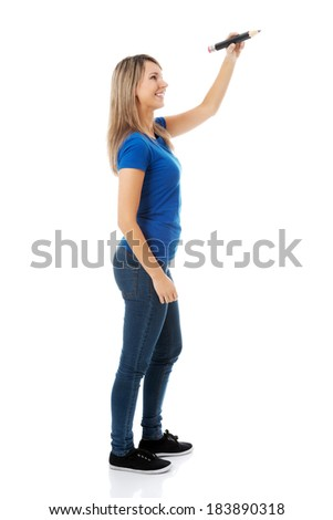 Young casual woman writing on copy space. Isolated on white.  - stock photo