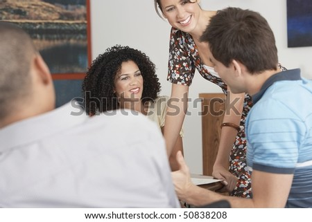 Young, casually dressed Businesspeople holding a Meeting - stock photo