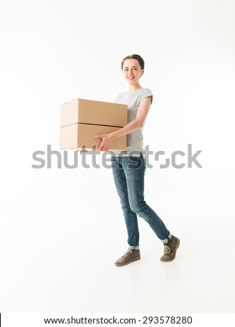 young cauacsian woman carrying moving boxes, on white background