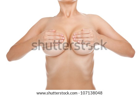 Young Caucasian adult woman examining her breast for lumps or breast cancer, isolated over white background - stock photo