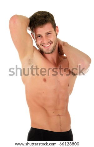 Young caucasian athletic man showing muscle. Happy and invigorated look. Studio shot. White background - stock photo