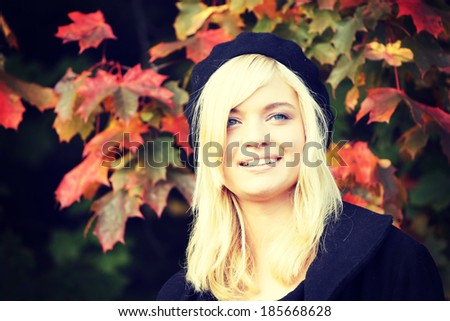 Young caucasian blonde woman portrait with autumn background - stock photo