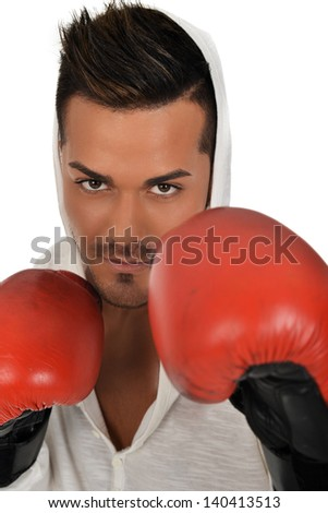 young caucasian boxer training with gloves and not
