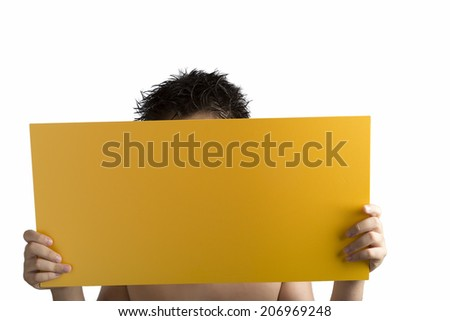 Young caucasian boy holding a yellow orange plywood square blank signboard with hands on white background. Face is covered and there are no elements to distract from reading any message on the sign - stock photo
