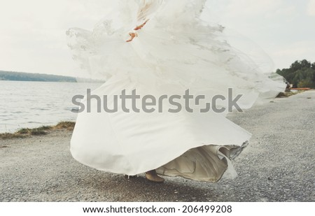 Young caucasian bride in  gorgeous wedding dress. - stock photo
