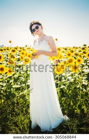 young caucasian bride in sunflowers - stock photo