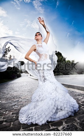 young caucasian bride posing outdoor in white luxury dress - stock photo