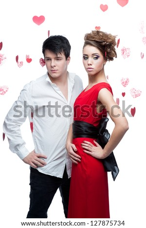 young caucasian brunette couple. woman with gorgeous fashion look and man on background looking at her