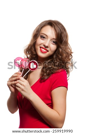 Young caucasian brunette woman holding lollipops - stock photo