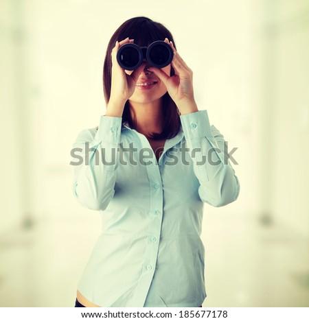 Young caucasian business woman looking throught binocular  - stock photo