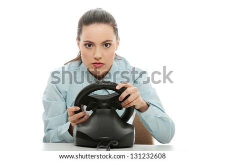 Young caucasian business woman playing on computer (with steering wheel), isolated on white background - stock photo