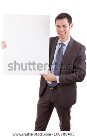 Young caucasian businessman holding a white board, isolated on whitebackground