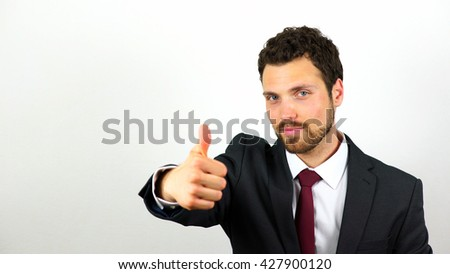 Young Caucasian businessman showing thumbs up. Businessman approves. Studio shot. White background. - stock photo