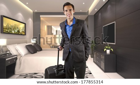 young caucasian businessman travelling with luggage or baggage in a hotel