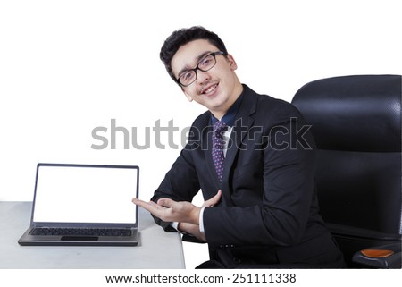 Young caucasian businessperson with empty laptop screen smiling at the camera, isolated on white - stock photo