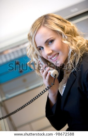 young caucasian businesswoman answering to the phone - stock photo
