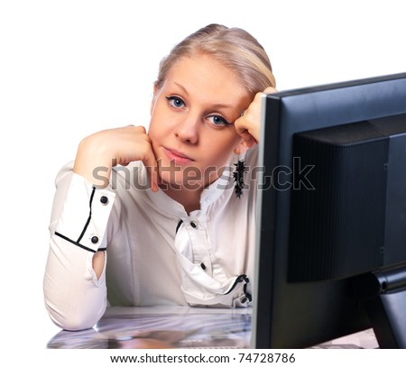 Young caucasian businesswoman sitting at desk/ Isolated on white background.