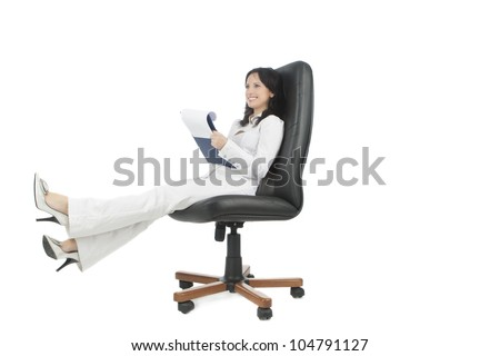 young caucasian businesswoman sitting in black chair with a brilliant natural smile isolated over white background