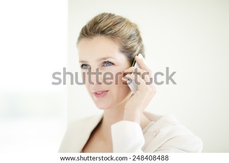 Young Caucasian businesswoman talking on phone. - stock photo