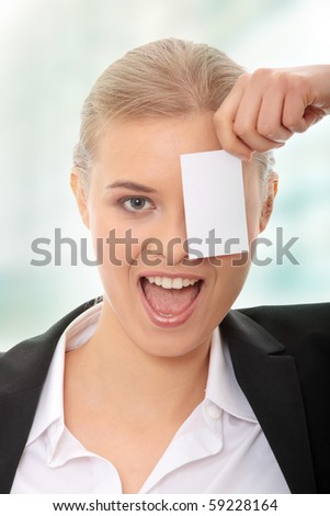 Young caucasian businesswoman with business card - stock photo