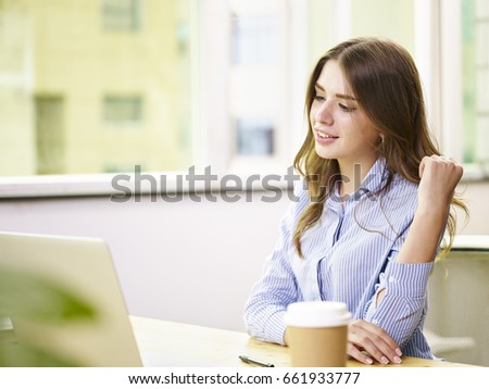 young caucasian businesswoman working in office using laptop computer.