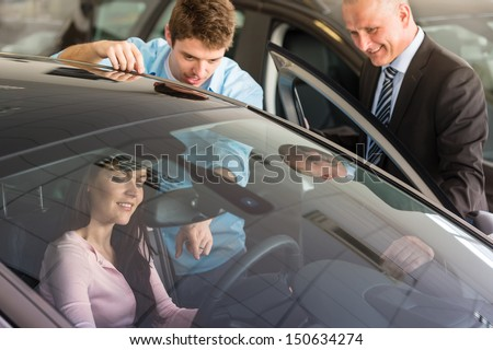 Young Caucasian couple choosing car - stock photo