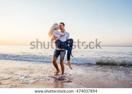 young caucasian couple having fun on beach