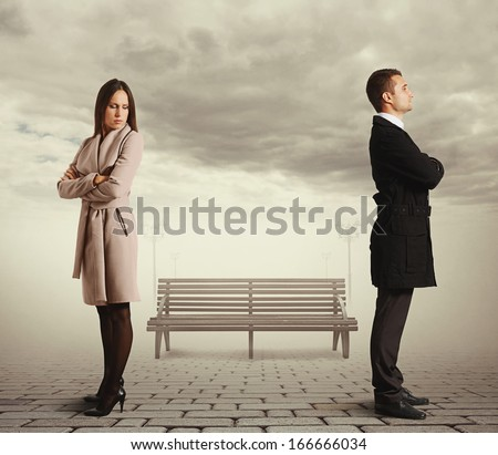young caucasian couple in quarrel - stock photo