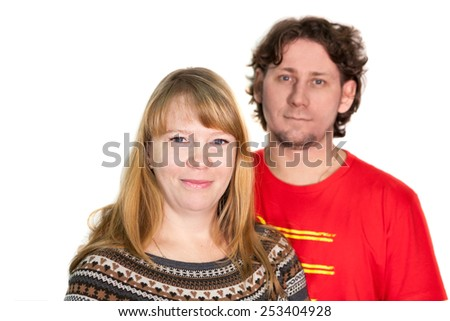 Young Caucasian couple portrait on a white background - stock photo