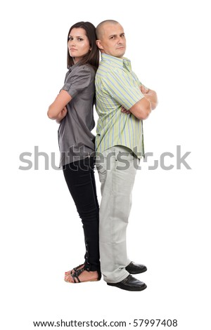 Young caucasian couple standing back to back, isolated on white - stock photo