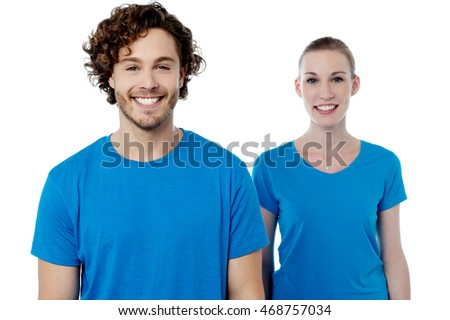 Young caucasian couple wearing same color dress.