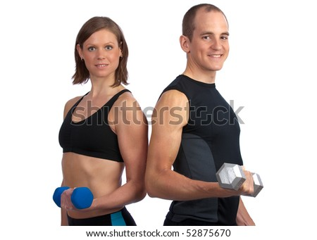 Young, caucasian couple working out with dumbbells, smiling at camera