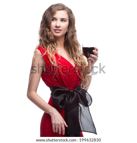 young caucasian elegant woman in red long dress holding wineglass isolated on white - stock photo