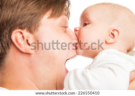 Young Caucasian father playing with baby son over white background