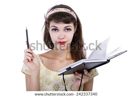 young caucasian female with sketchbook and pencil on white background - stock photo