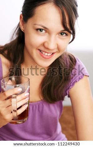 young caucasian girl drinking tea