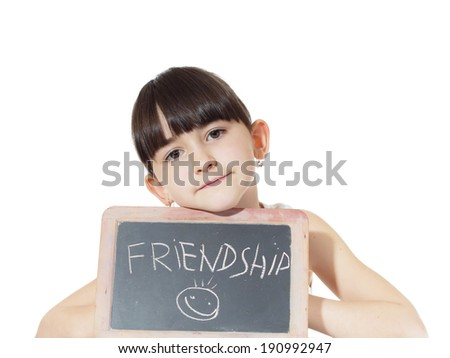 Young caucasian girl holding chalkboard signed friendship isolated on white