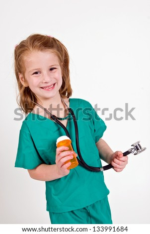 Young caucasian girl playing doctor - stock photo